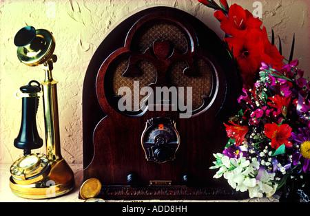 Old phone and radio - Stock Photo