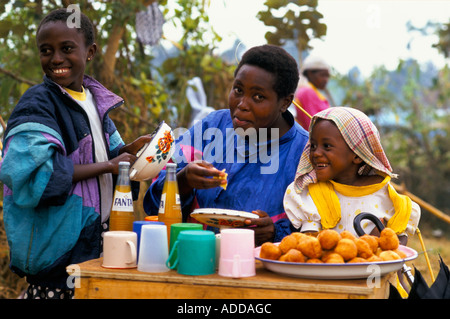 Kashusha camp: A mother her and her two daughters run a little stall at the camp selling snacks soft drinks. - Stock Photo
