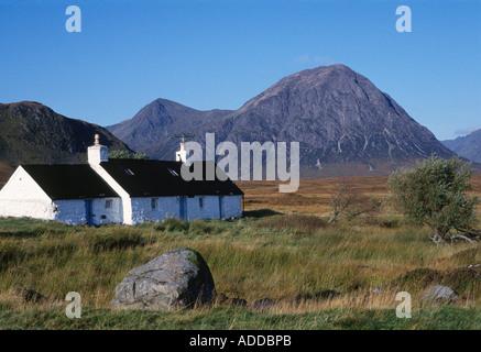 Blackrock Cottage and Buachaille Etive Mor peak on Rannoch Moor, West Highlands, Scotland, UK - Stock Photo