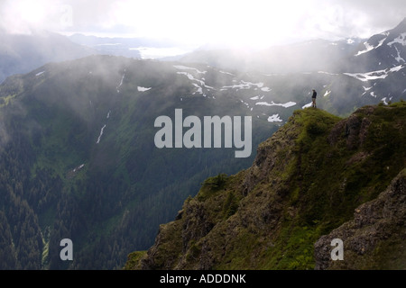 Hiker on Eagle Peak promontory Admiralty Island Tongass National Forest Southeast Alaska Summer - Stock Photo