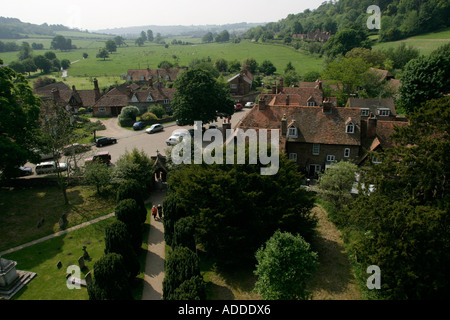 High view from the clock tower of  two people walking to church in Hambleden village. - Stock Photo