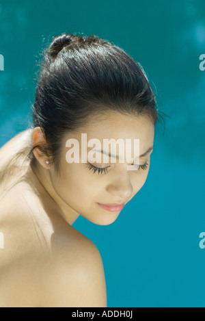 Young woman with bare shoulders, head and shoulders, portrait, high angle view - Stock Photo