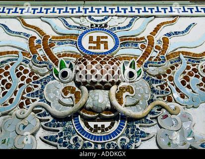 Mosaic panel of dragon and swastika at 'Long Son Pagoda', near 'Nha Trang', central Vietnam. - Stock Photo