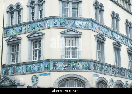 Painted reliefs on Sunlight Chambers at Essex Quay in Dublin Ireland - Stock Photo