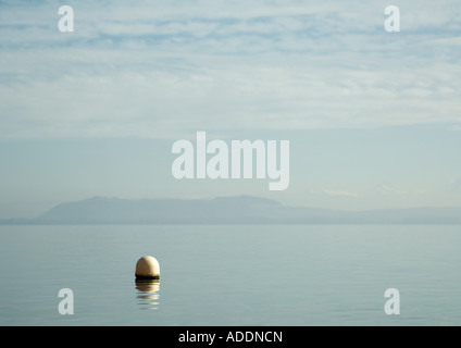 Seascape, buoy in foreground - Stock Photo