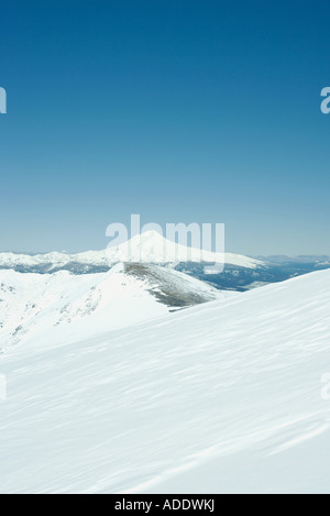 Snow-covered mountainous landscape - Stock Photo