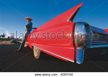 A cowboy leaning on a pink cadillac, Route 66, Arizona, USA - Stock Photo