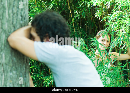 Couple playing hide and seek together - Stock Photo