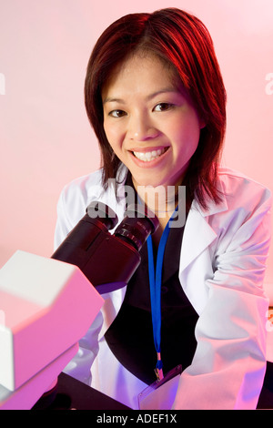 Researcher, microbiologist or pathologist uses a light microscope. - Stock Photo