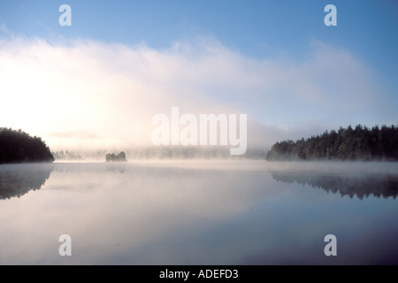 Early morning fog lifting off of st. john river in New Brunswick Canada - Stock Photo