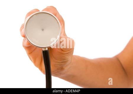 Female doctor's hand holding the chest piece of a stethoscope towards a patient. Isolated on white - Stock Photo