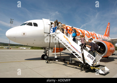 Passengers boarding easyJet aircraft at Cracow airport Poland - Stock Photo