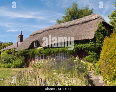 Picturesque thatched cottage and front garden in village of Slindon West Sussex England UK Britain - Stock Photo