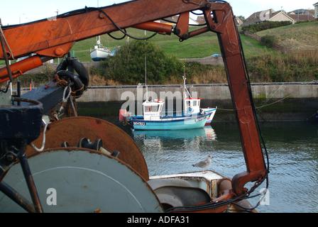 Small Inshore Fishing Boats Framed in Hoist at Eyemouth Harbour Scotland United Kingdom UK - Stock Photo