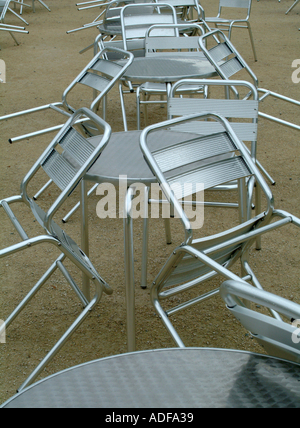 Empty Aluminium Dining Chairs and Tables at Alnwick Gardens Northumberland England United Kingdom UK - Stock Photo