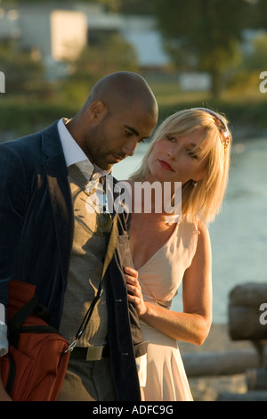 Close Up Head and Shoulders Interracial love story of a black man and a white woman - Stock Photo