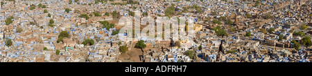 A 4 picture stitch panoramic view of the 'Blue City' of Jodhpur from the Mehrangarh Fort ramparts. - Stock Photo