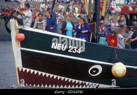 Fishing trawler at the festival Krabbenkutterregatta in Neuharlingersiel North Sea Coast Lower Saxony Germany - Stock Photo