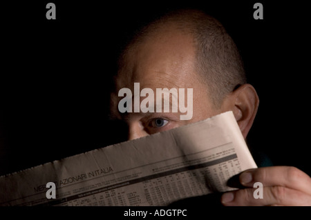 lecture of a newpaper - Stock Photo