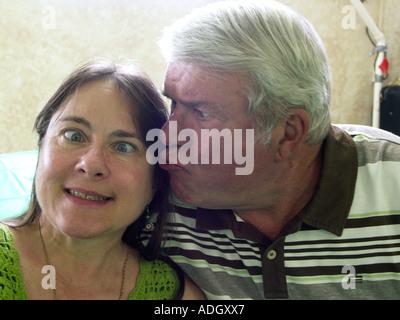 Kissing Cross Eyed Girl - Stock Photo