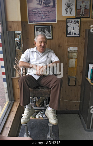 In Little Havana in Miami Florida on Calle Ocho 7th street in the afternoons Barber in his shop - Stock Photo