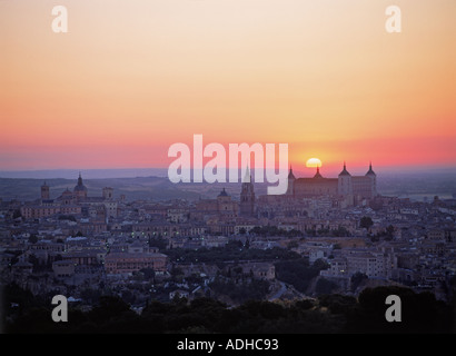 Alcázar fortress dominating skyline of Toledo at sunset with The Cathedral