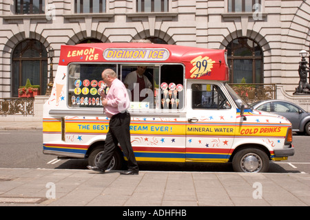 Ice Cream van during hot weather in City of London with office worker purchasing cone - Stock Photo