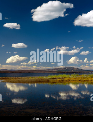 Beautiful fair weather clouds hover over Yellowstone Lake in Yellowstone National Park in Wyoming USA - Stock Photo