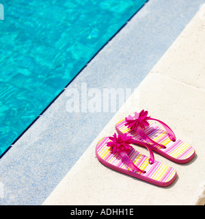 Sandals on poolside - Stock Photo