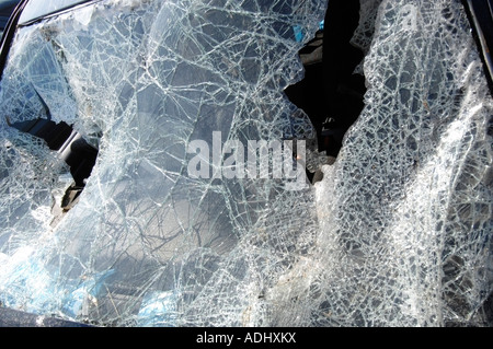 The shattered windscreen of a car wrecked in a road accident - Stock Photo