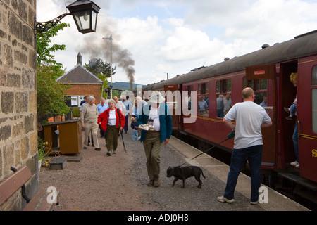 Passengers disembarking from Strathspey Railway,  Boat of Garten steam railway station Glen Bogle, Scotland uk - Stock Photo