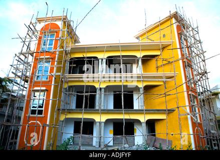 Mauritius development using primitive scaffolding methods - 'Flic en Flac', 'Mauritius' - Stock Photo