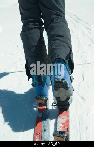 Skier, close-up of legs, rear view - Stock Photo