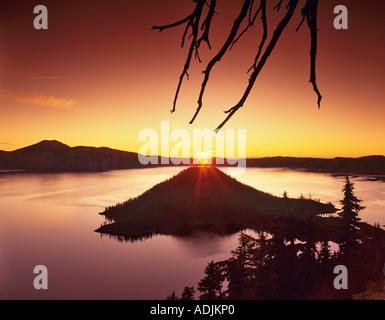 Crater Lake and Wizard Island at sunrise Oregon - Stock Photo