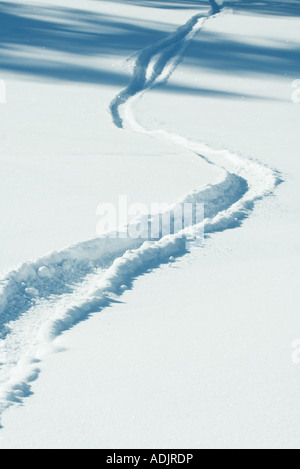Tire track in snow - Stock Photo
