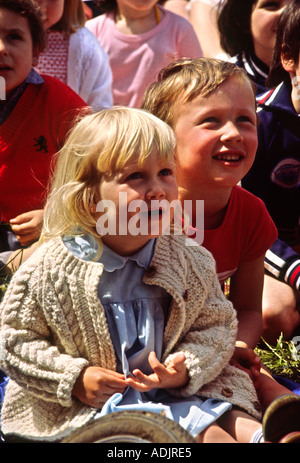 Entertainment Children in audience watching Punch and Judy Show - Stock Photo
