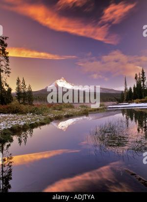 Mount Washington reflection in Big Lake with snow and sunset Oregon - Stock Photo