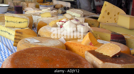 Cheese for sale on market Different cheeses for sale at local market in Berlin Germany - Stock Photo