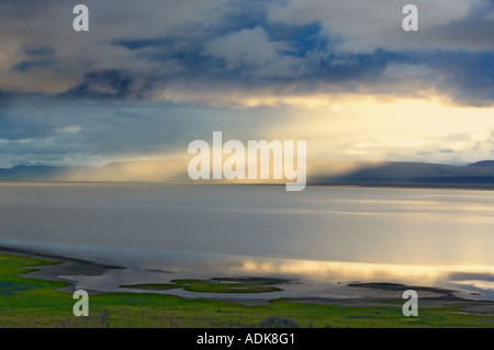 Sunrise on Summer Lake with storm clouds Oregon - Stock Photo