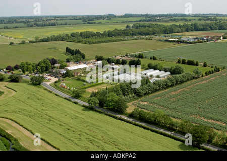 Oblique high level aerial view south east of Abridge area with Patch Park Nurseries London RM4 England 2005 - Stock Photo