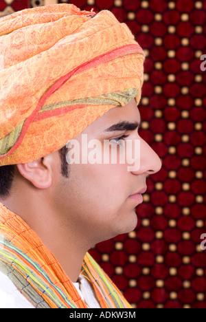 Side view of a young Pakistani Muslim man wearing a turban - Stock Photo