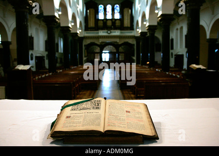 18th century roman missal in latin sitting open on the altar of Holy Cross church ardoyne belfast - Stock Photo