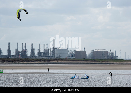 Two kite surfers walking along the beach with kite at South Gare near Redcar Teesside Cleveland UK - Stock Photo