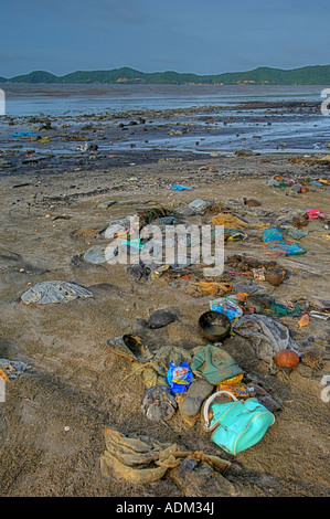 Pollution on a beach in Chantaburi Thailand The waste has been washed up from the gulf of siam at high tide in August - Stock Photo