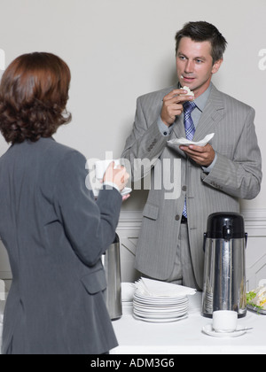 Office workers having a coffee break - Stock Photo