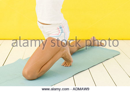 Woman in a yoga position - Stock Photo