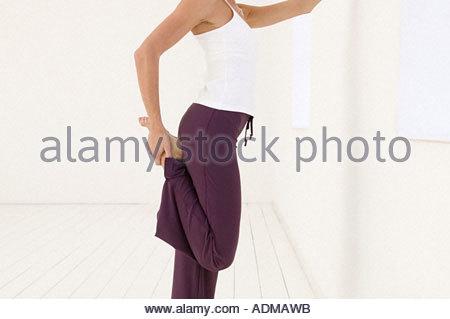 Woman stretching her leg - Stock Photo