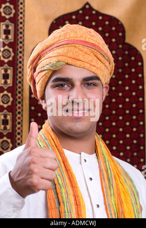 Arabic man with head scarf and thumbs up - Stock Photo