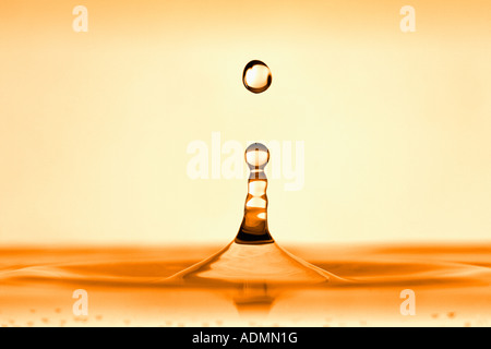 WATER DROPLET FALLING INTO WATER - Stock Photo