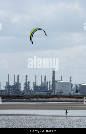 A kite surfer walks along the beach with his kite near Redcar Teesside Cleveland UK - Stock Photo